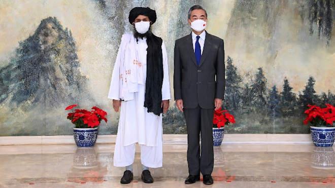 Abdul Gáni Baradar és Vang Ji
